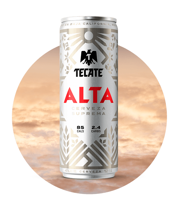 Tecate® Alta, silver can 12fl oz, with Mexican fretwork design. 85 Cals & 2.4 Carbs..